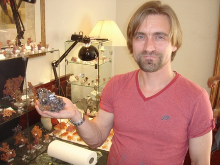Mikhail Anosov of Russian Minerals posing with Cuprite